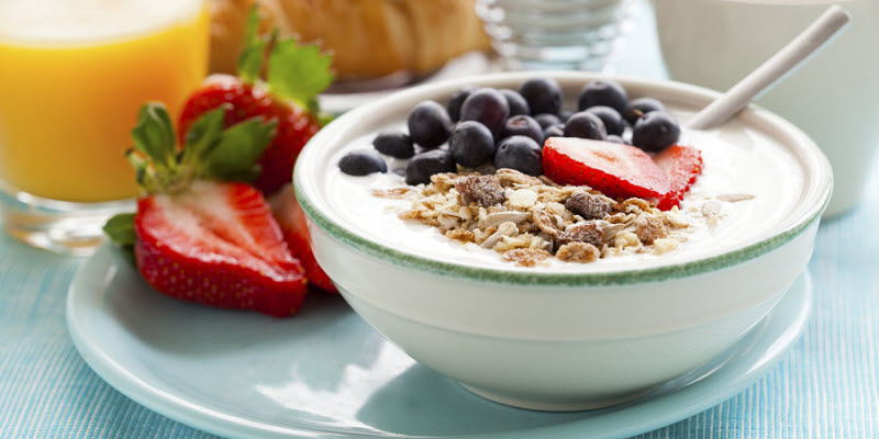 Wholegrain Granola Topped with Skimmed Milk and Fruit